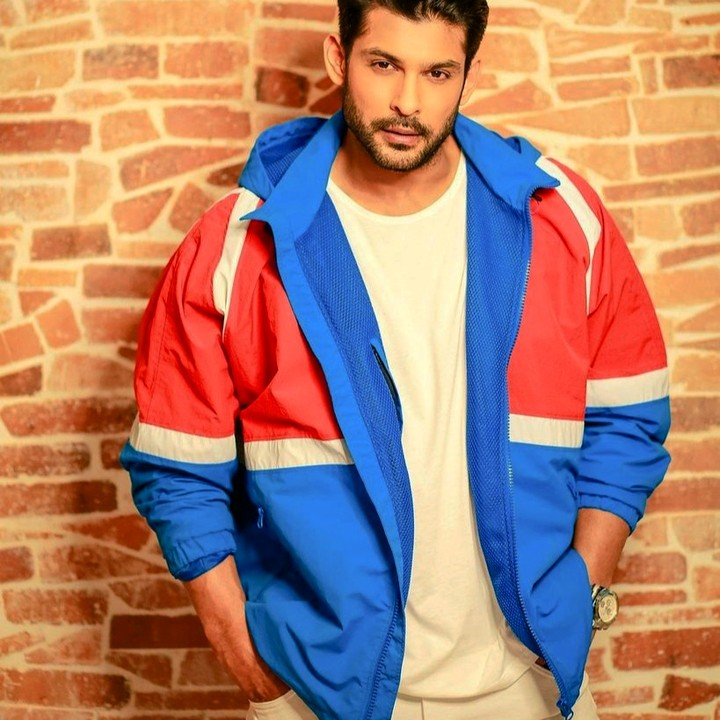 Sidharth Shukla standing in blue jacket - india celebrities who dies of heart attack