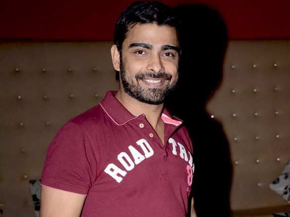 Abir Goswami smiling and posing in a marron t-shirt - actor who dies of heart attack